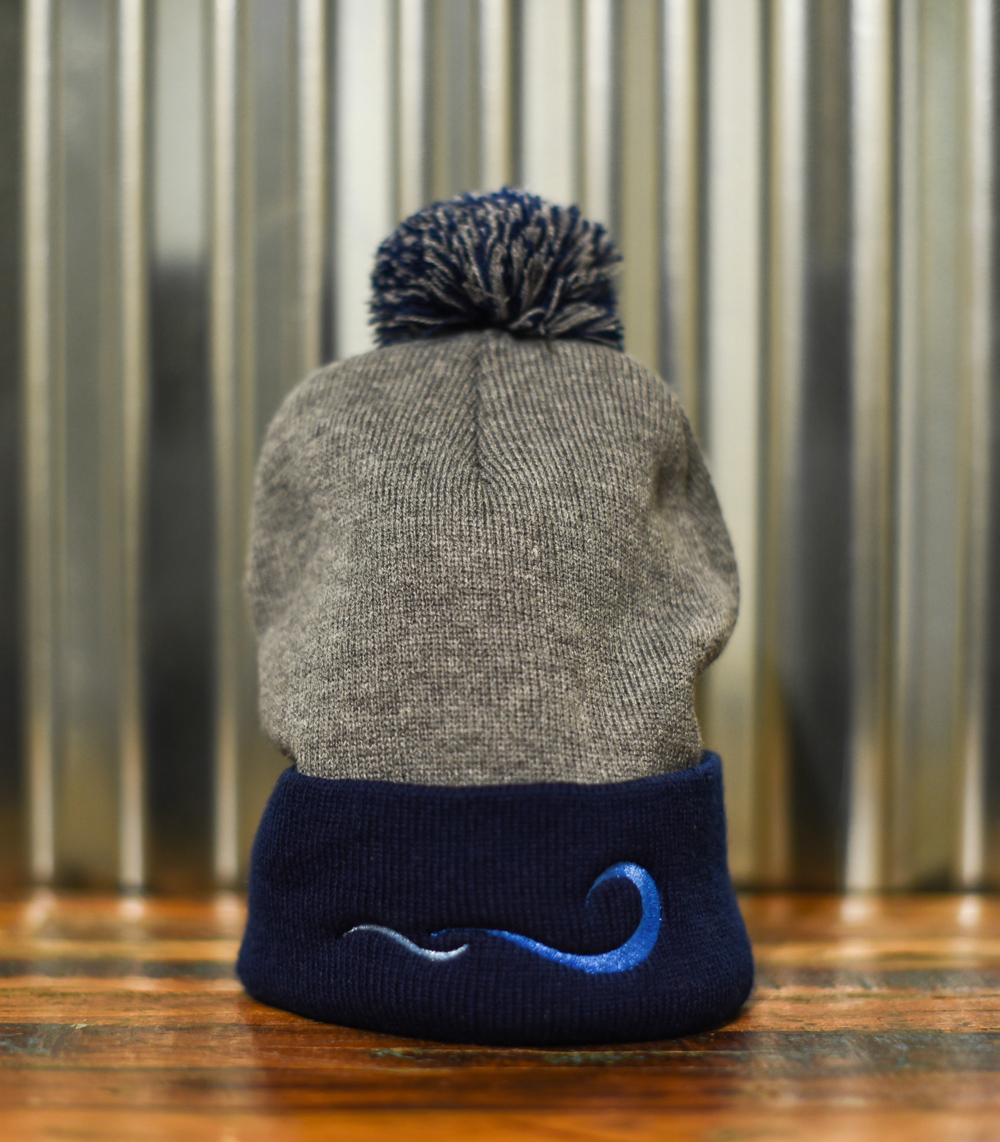 Pompom Beanie – Navy and gray with embroidered front view