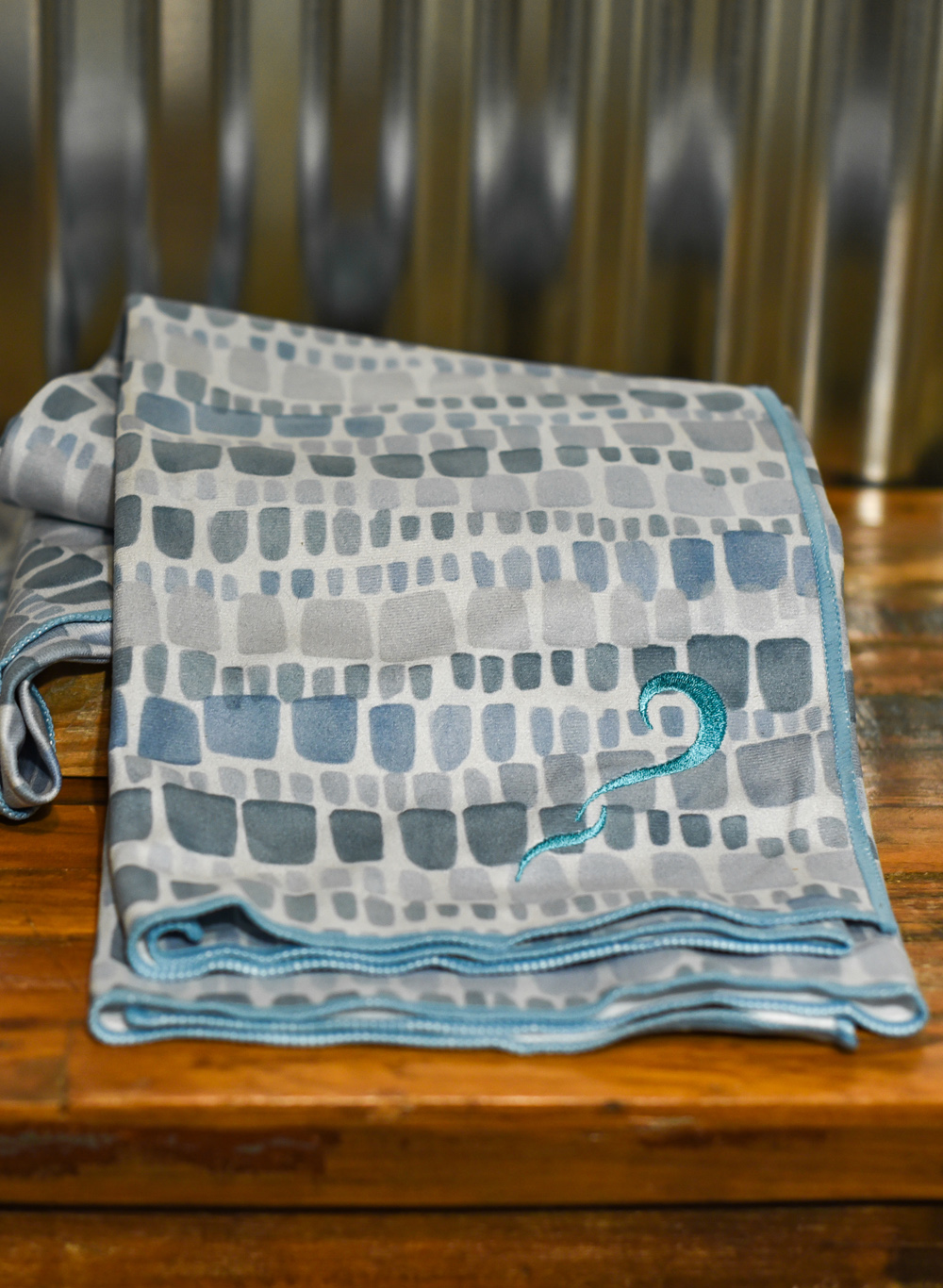 Embroidered with TYC wave, yogi toes Patina Squares towel